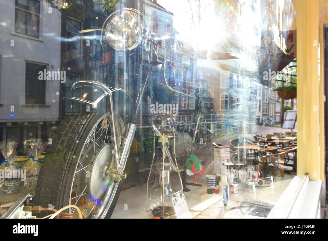 a shop window displaying a vintage bmw motorcycle in delft, south