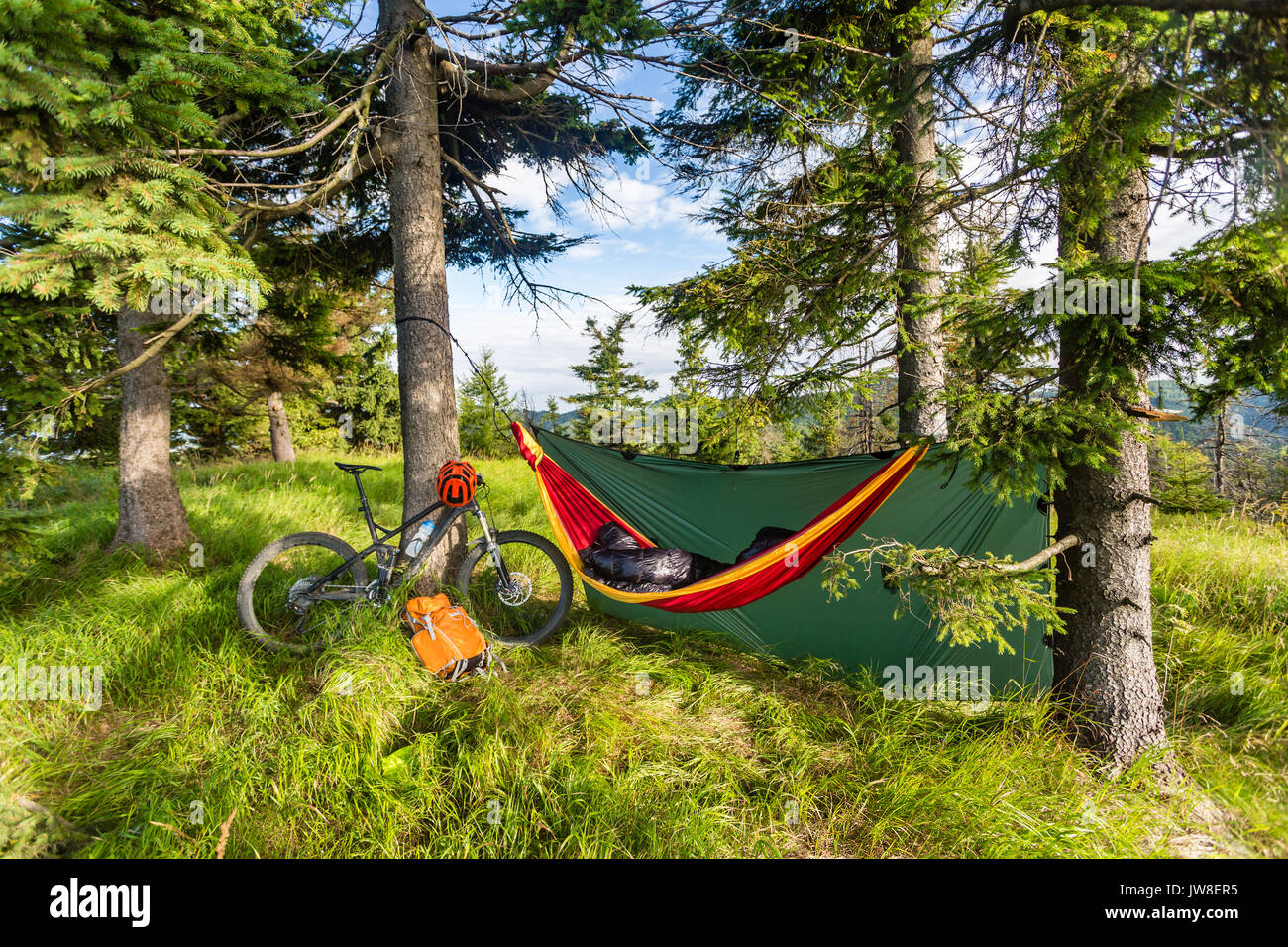 camping in woods with hammock and sleeping bag on mountain biking adventure trip in green mountains camping in woods with hammock and sleeping bag on mountain biking      rh   alamy