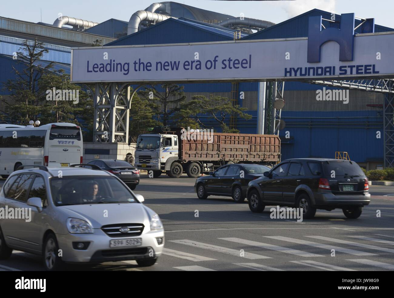 Cars pass a factory of Hyundai Steel just opposite the large South ...