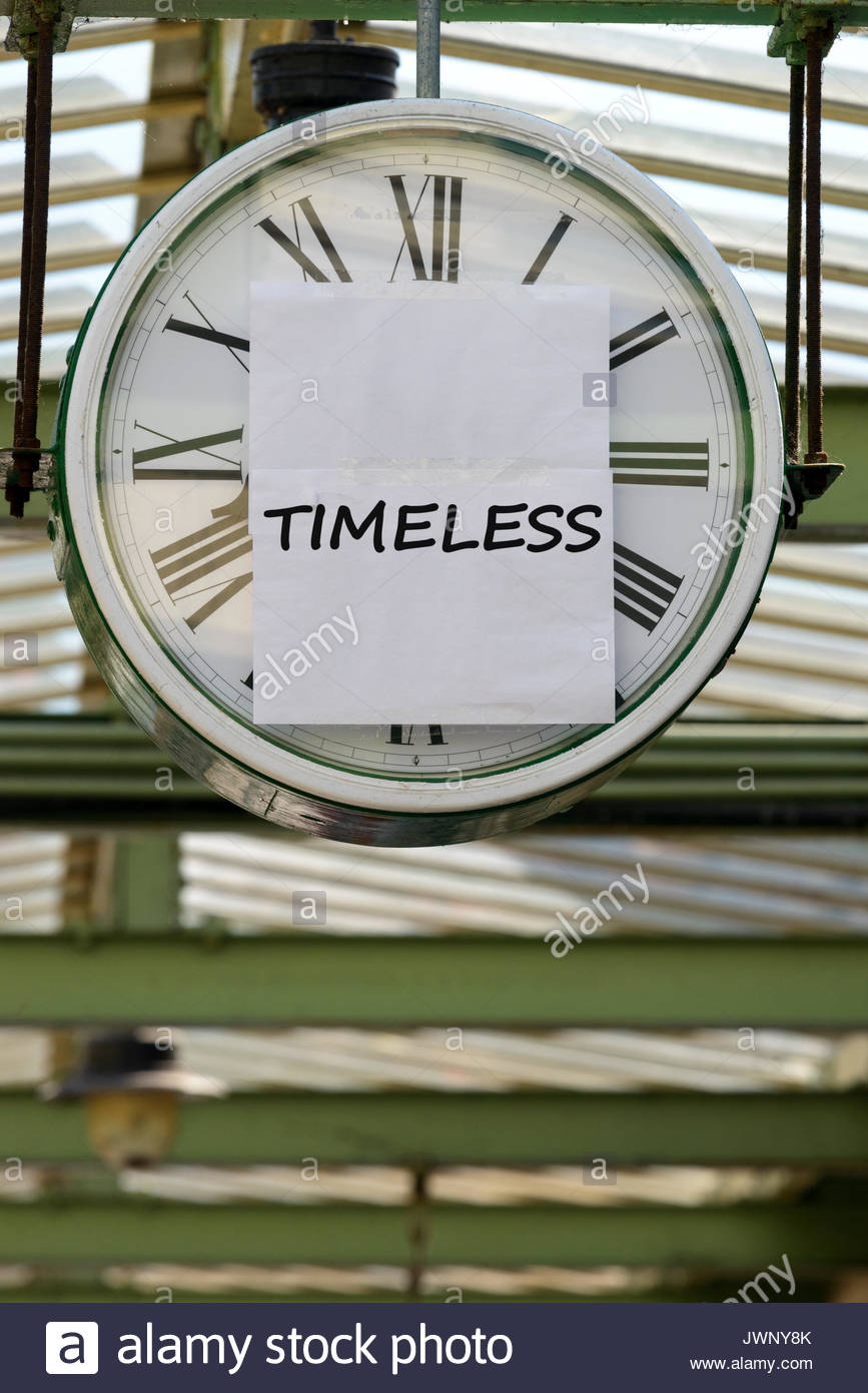 timeless written on clock swanage dorset england uk stock photo