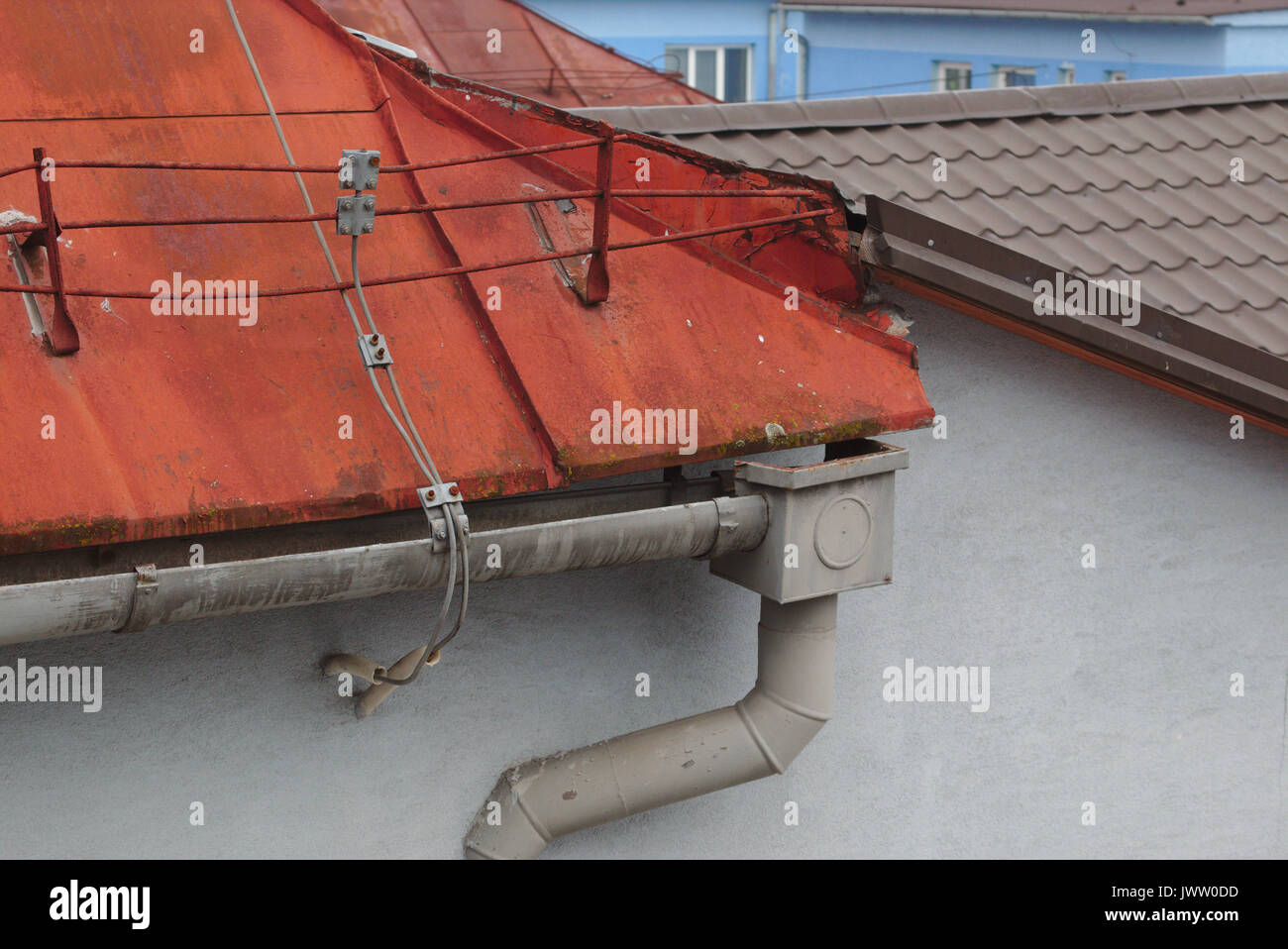 Rusty Metal Roof With Gutter And Lightning Conductor   Stock Image