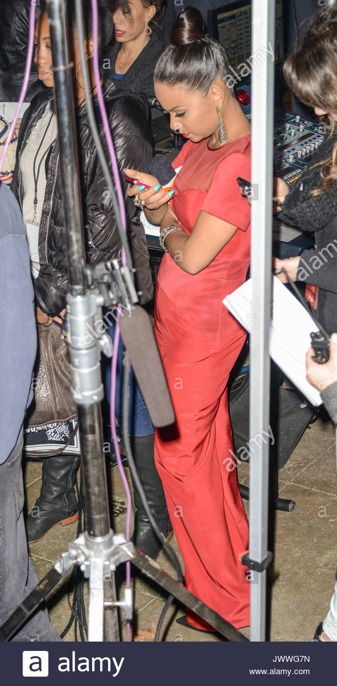 Christina Milian hides in the sound tent to avoid the rain during the  sc 1 st  Alamy & Christina Milian. Christina Milian hides in the sound tent to ...