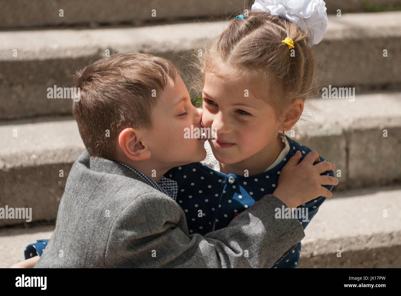 Little boy kissing an older girl stock photo 153692081 alamy little boy kissing an older girl altavistaventures Images