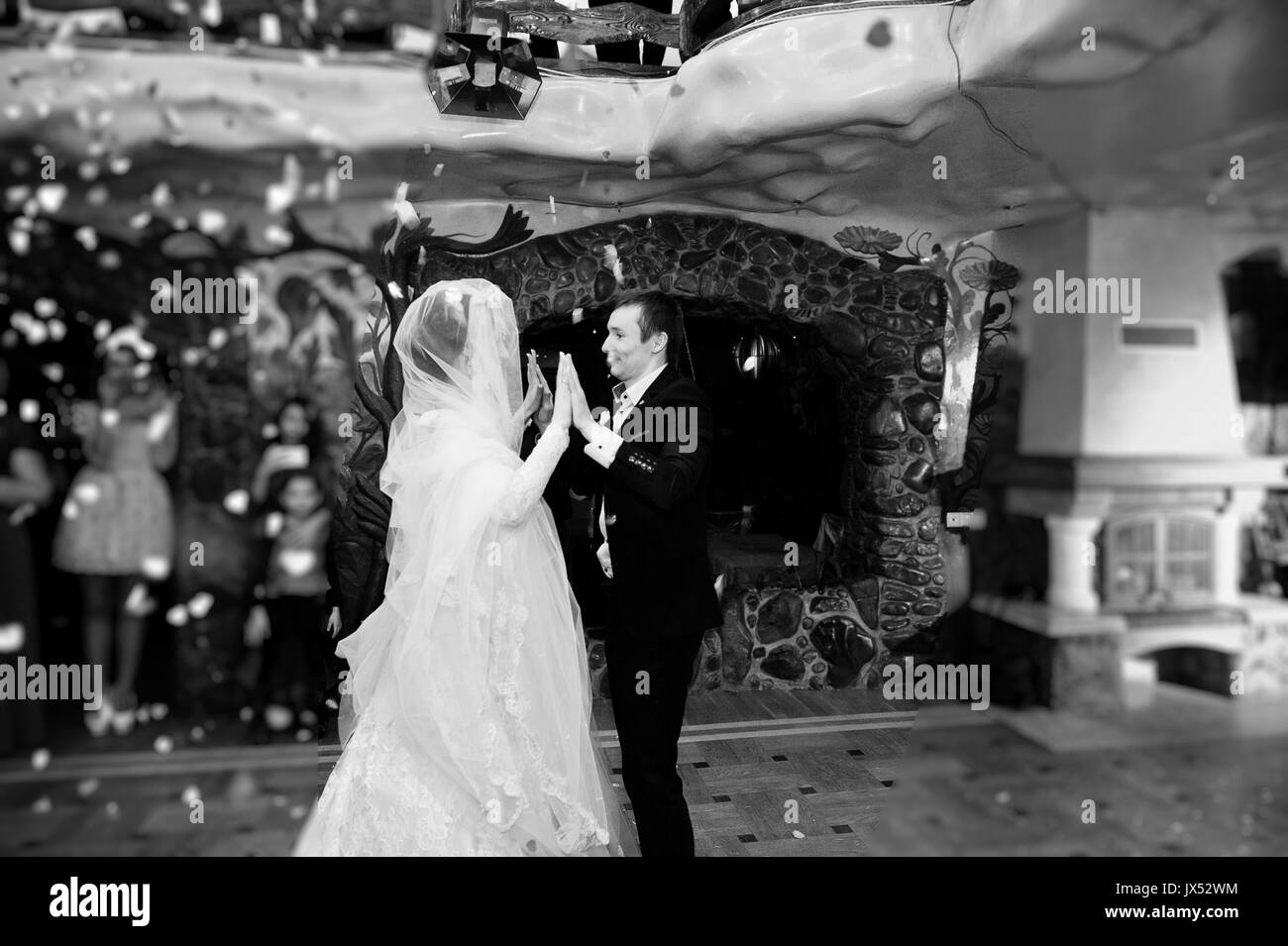 Wedding Couple Dancing Their First Dance In The Restaurant With Confetti On Floor Black And White Photo