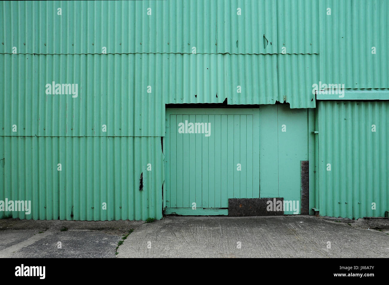Side of green corrugated barn with double doors & Side of green corrugated barn with double doors Stock Photo ...