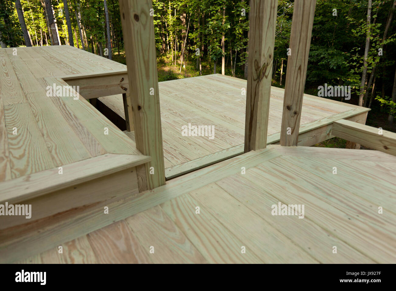 Lumber framing on a new deck with metal support Stock Photo ...