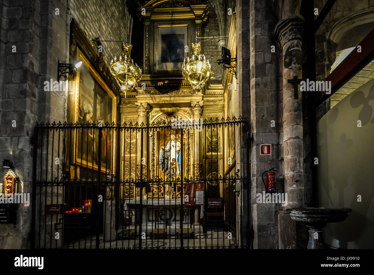 Small Dark Gothic Altar In A Church Rome With Lit Candles And Statue Of The Virgin Mary