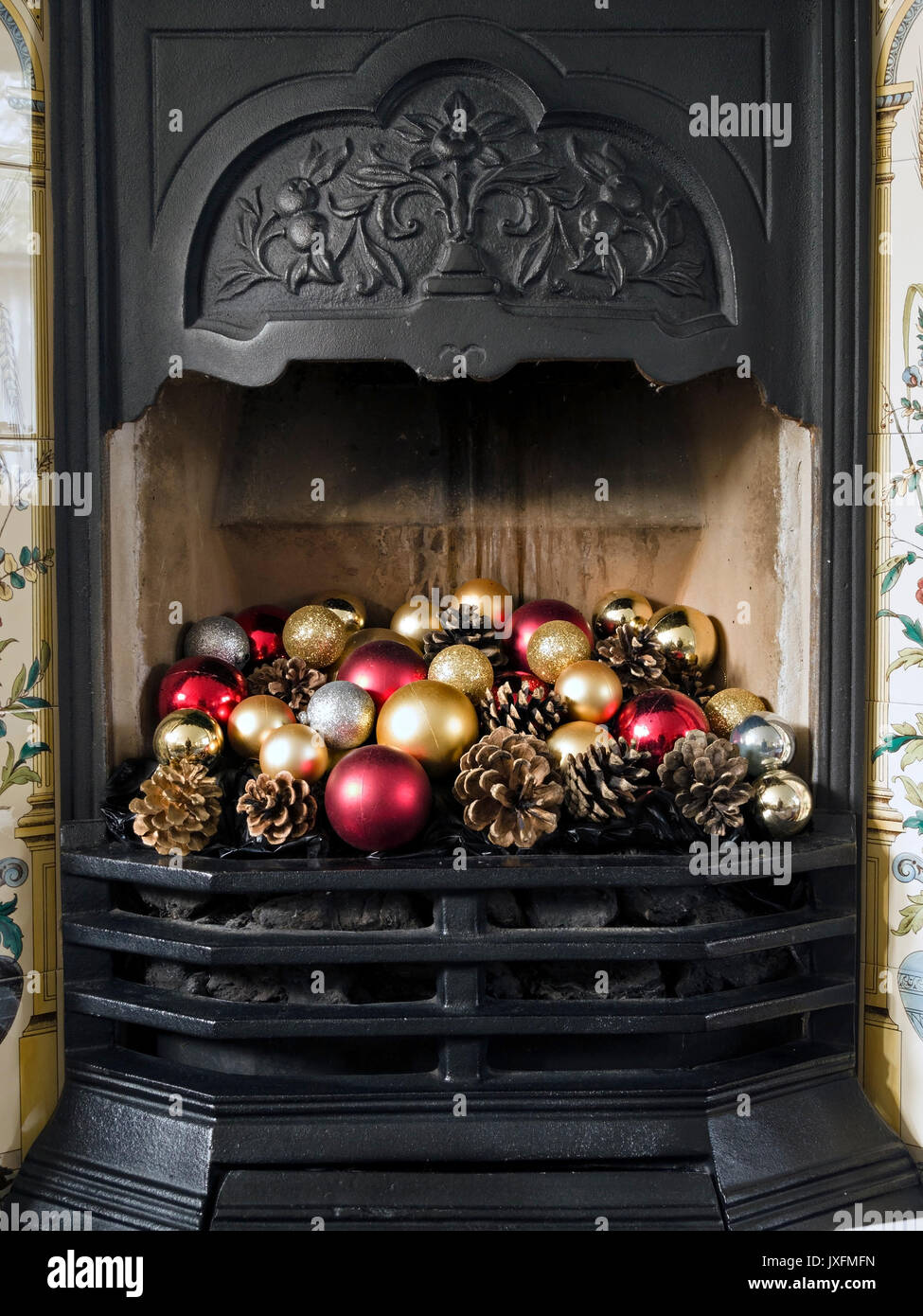 pretty victorian style cast iron fireplace and grate decorated