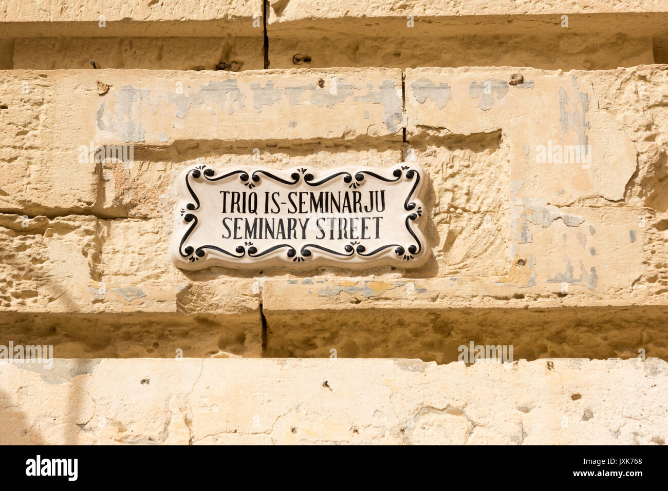 A ceramic street sign on a wall in the old town of Mdina Malta for ...
