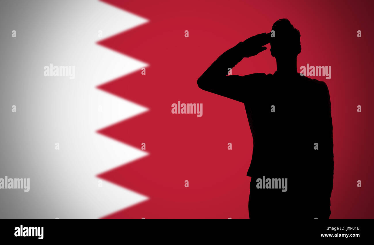 silhouette of a soldier saluting against the bahrain flag