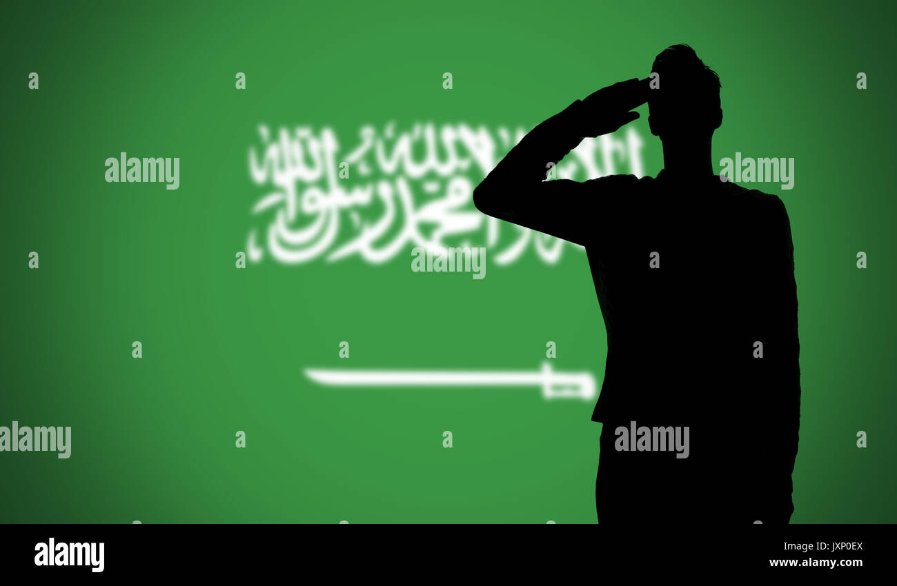 silhouette of a soldier saluting against the saudi arabia flag