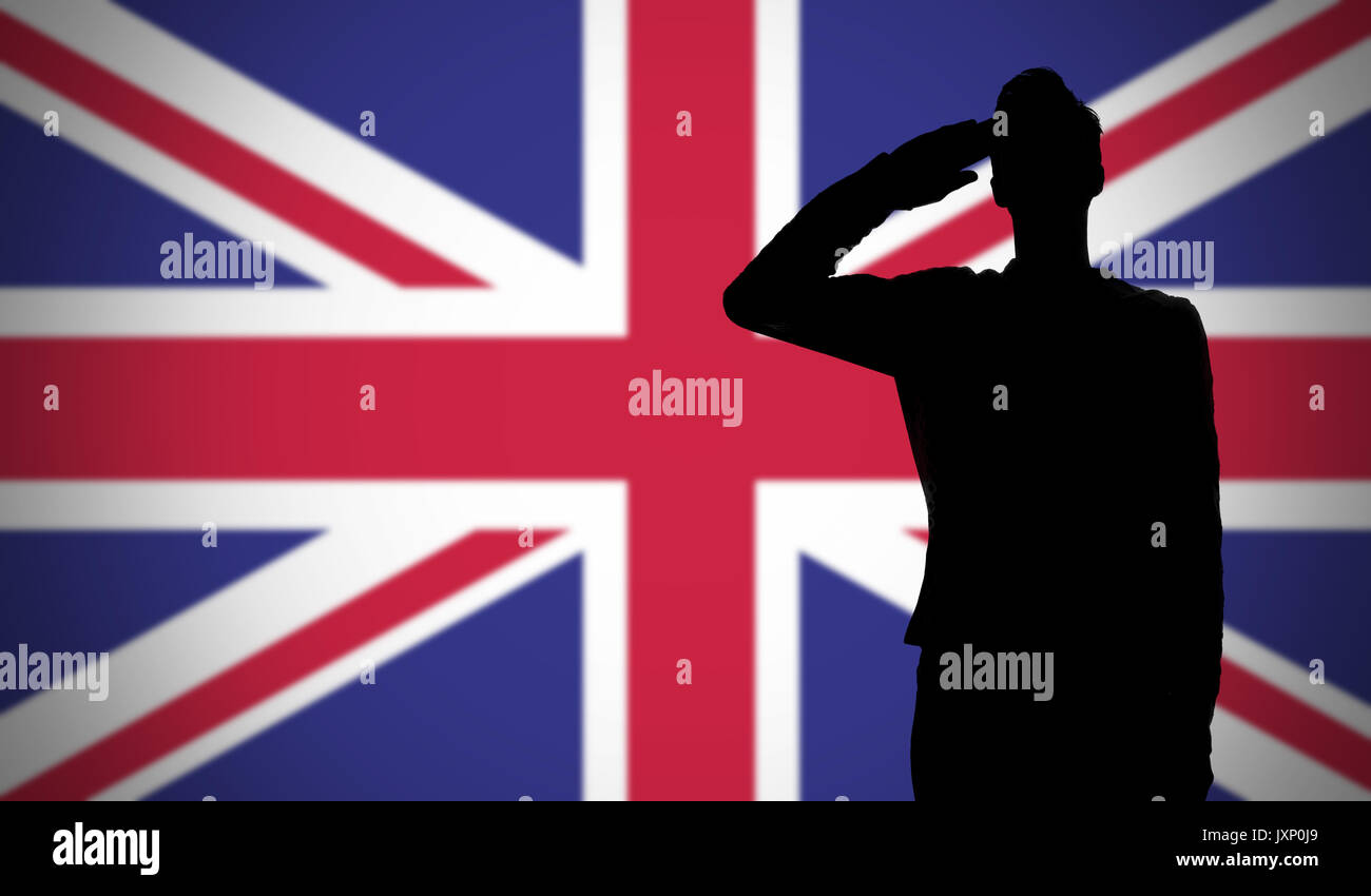 silhouette of a soldier saluting against the uk flag