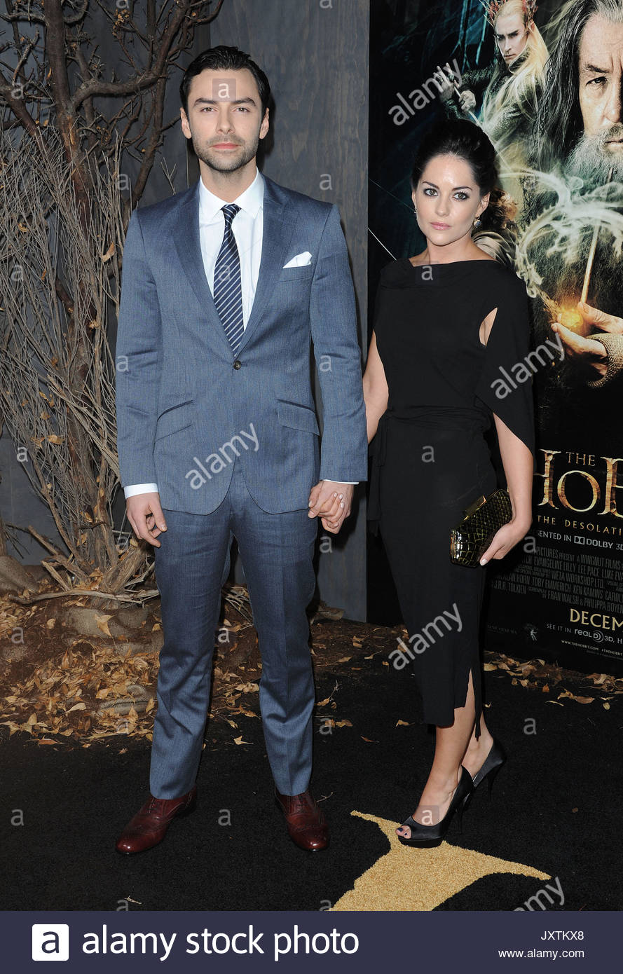 Aidan Turner and wife. Evangeline Lilly at the Los Angeles ...