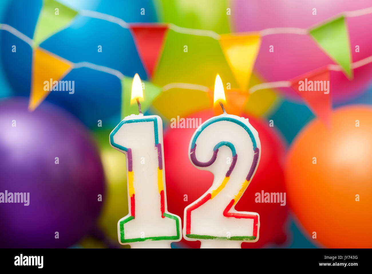 Happy Birthday Number 12 Celebration Candle With Colorful Balloons And Bunting