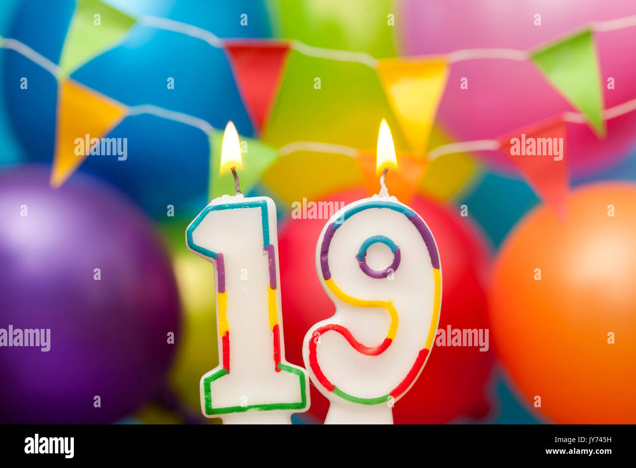Happy Birthday Number 19 Celebration Candle With Colorful Balloons And Bunting