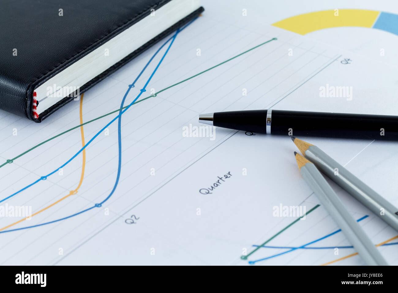 finance sheet charts office business man workspace desk with pen
