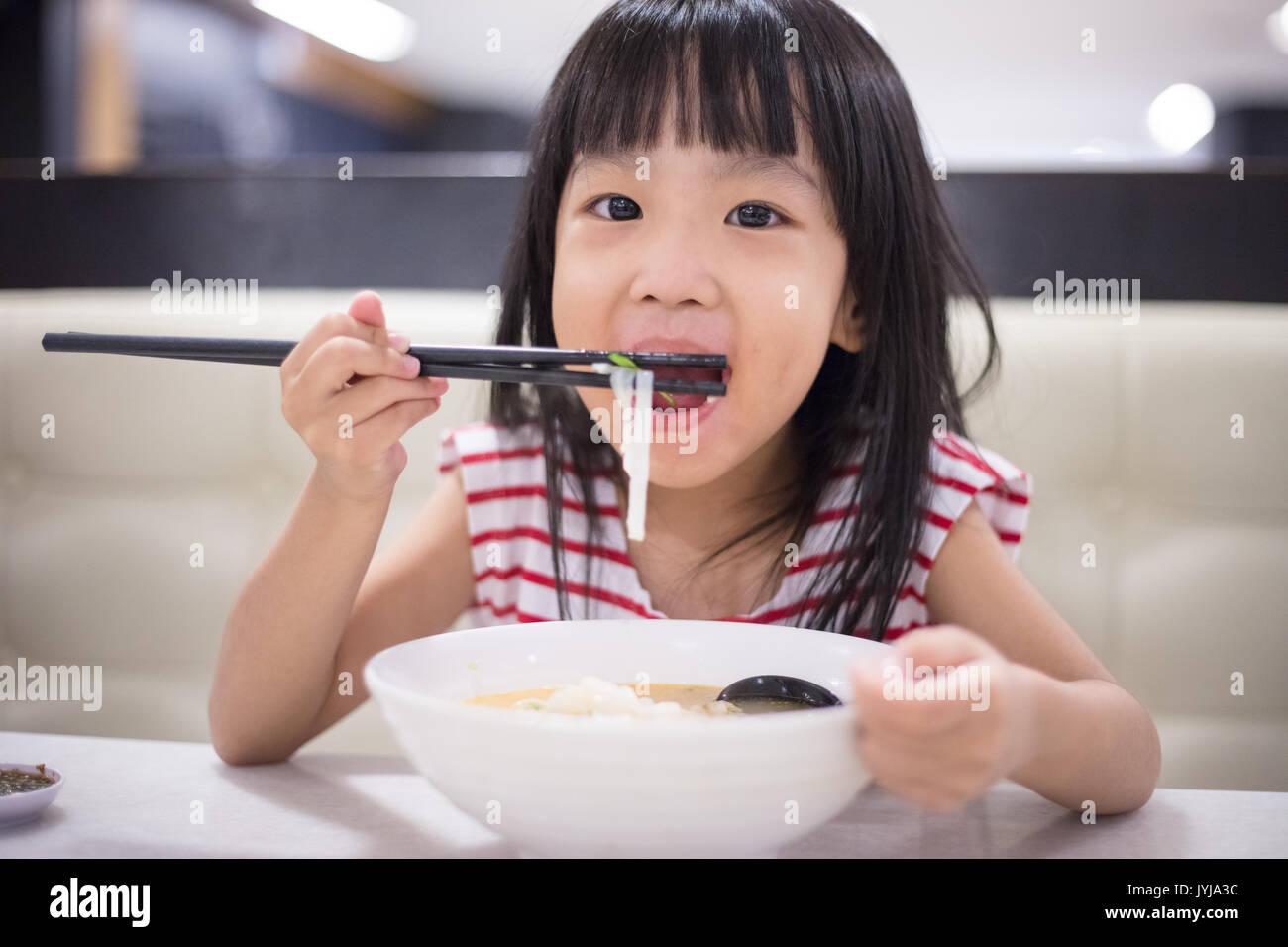 eating noodles Asian
