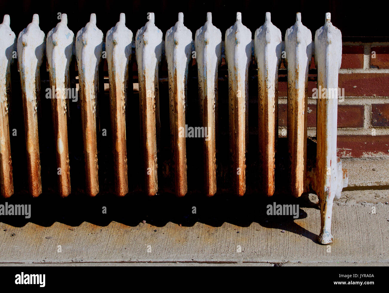 Old antique rusty decorated hot water radiator  Stock Image