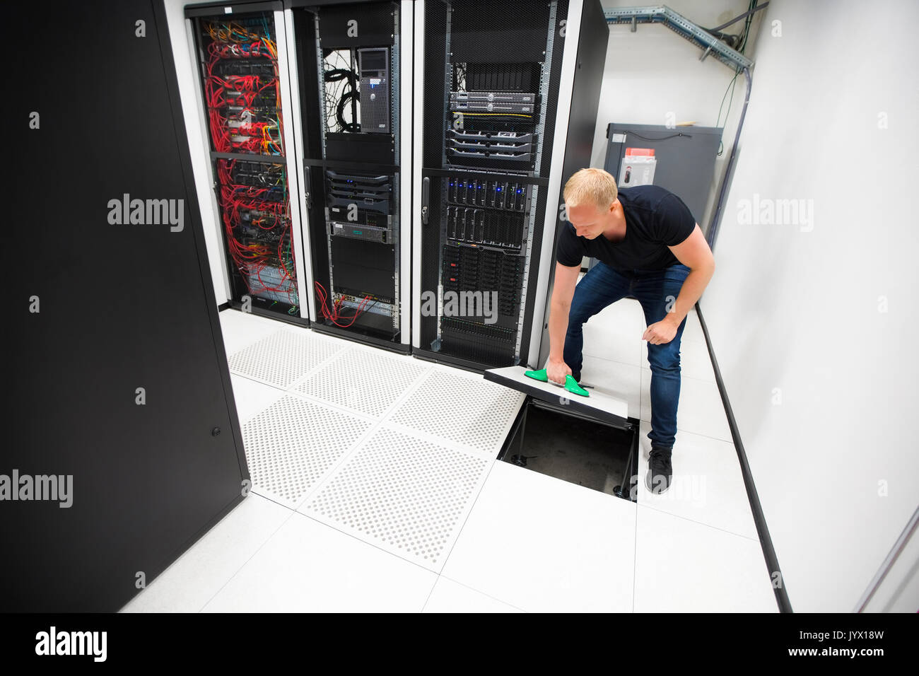 Computer engineer lifting floor tile using suction cups in datac computer engineer lifting floor tile using suction cups in datac dailygadgetfo Choice Image
