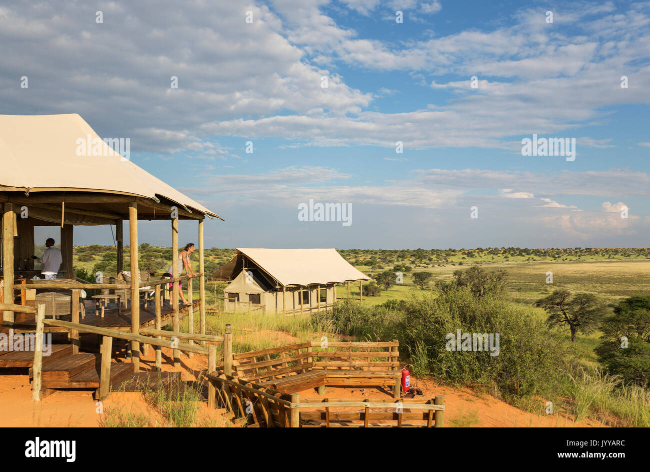 Lobby fireplace and stilted canvas tents Polentswa C& on the ridge of a sand dune during the rainy season with green & Lobby fireplace and stilted canvas tents Polentswa Camp on the ...