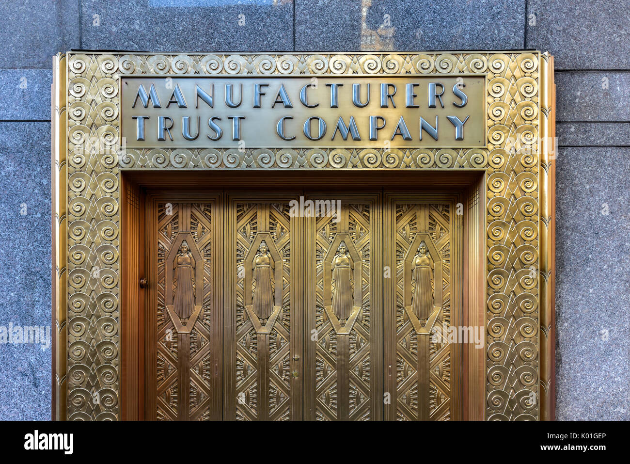 New York City - June 14 2017 Manufacturers Hanover Trust Company Bank former bronze door entrance in midtown Manhattan at the New Yorker Hotel. & New York City - June 14 2017: Manufacturers Hanover Trust Company ...