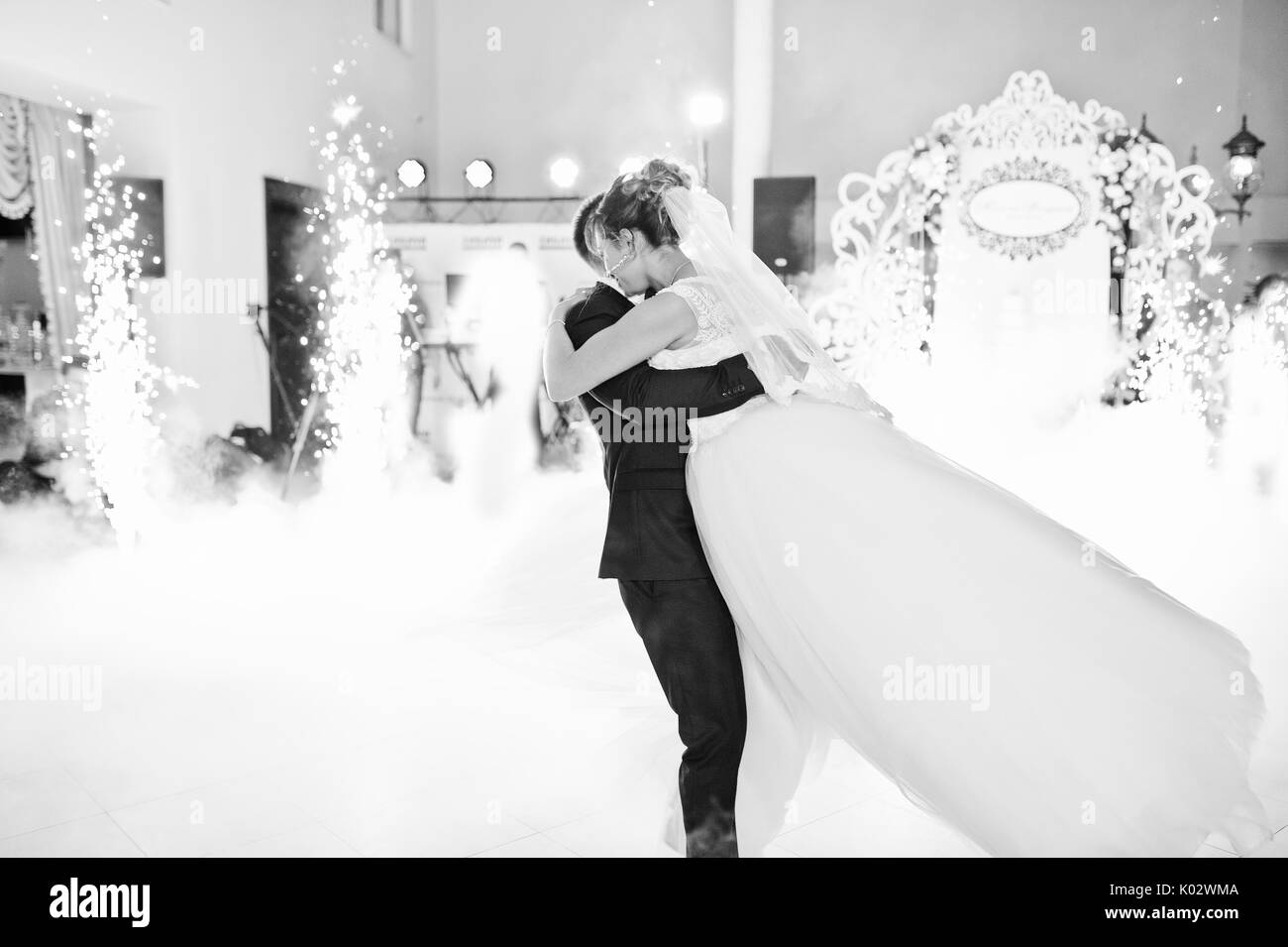 Beautiful Wedding Couple Dancing Their First Dance In The Huge Hall With Heavy Smoke Different Lights And People Looking At Them Black White Pho