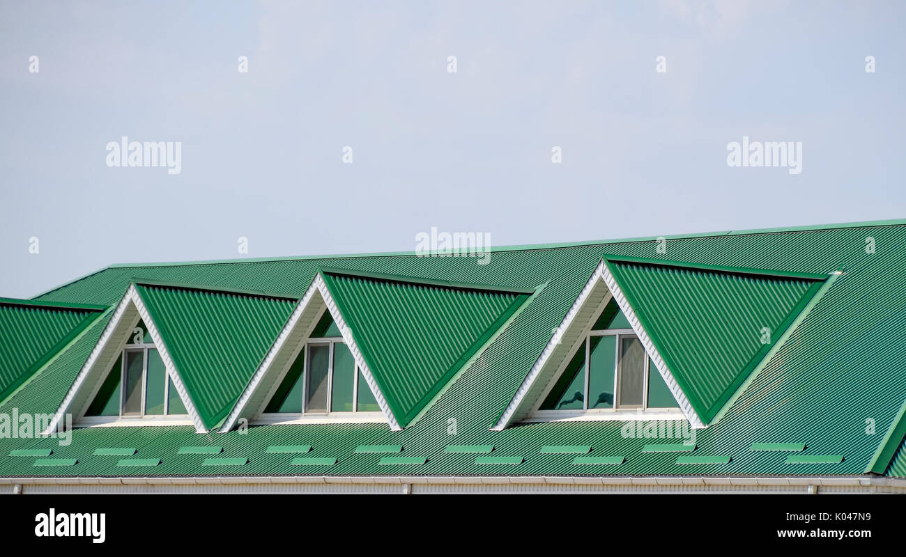 Stock Photo   The House With Plastic Windows And A Green Roof Of Corrugated  Sheet. Roofing Of Metal Profile Wavy Shape On The House With Plastic  Windows.
