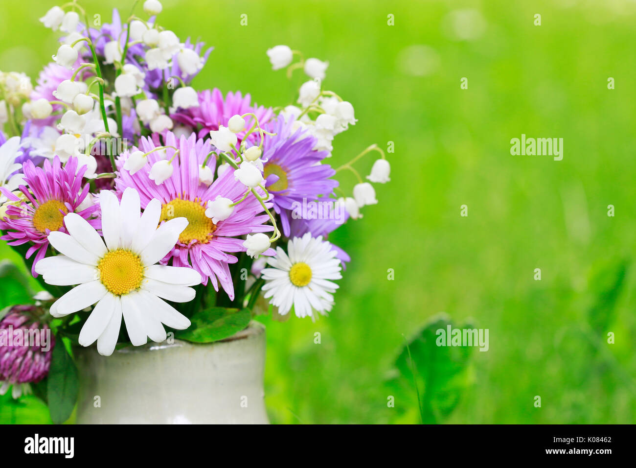 Cute bouquet of daisies carnations chamomile and lily of the cute bouquet of daisies carnations chamomile and lily of the valley flowers izmirmasajfo