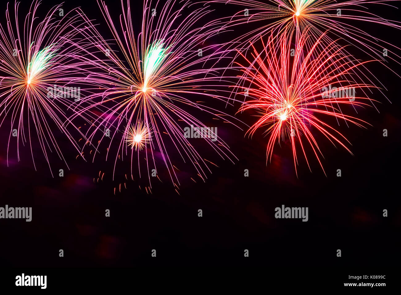 bright multicolored glowing balls of fireworks smart background for themes with different holidays with free space for text