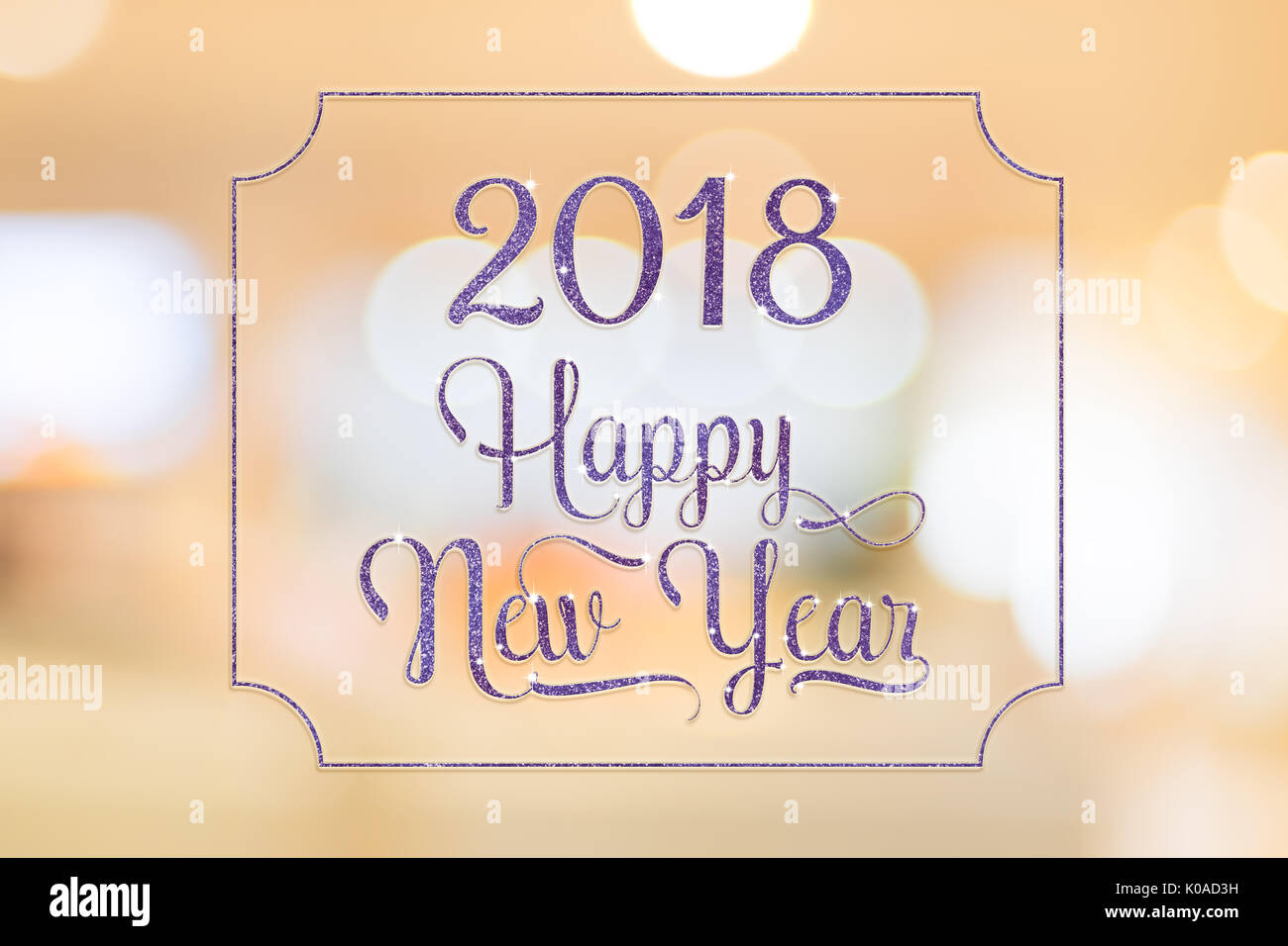 happy new year 2018 purple sparkling glitter word with golden frame at abstract blurred bokeh light background holiday concept