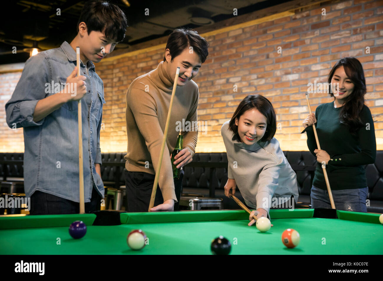 Game for coworkers - Smiling Coworkers Enjoying Billiard Game Stock Image