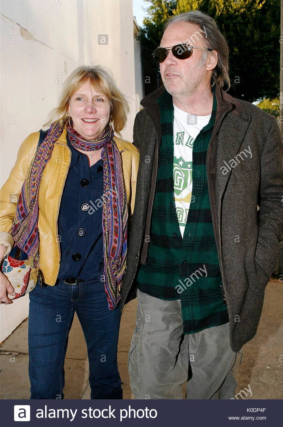 neil young and his wife pegi leave the ivy restaurant on robertson stock photo royalty free. Black Bedroom Furniture Sets. Home Design Ideas