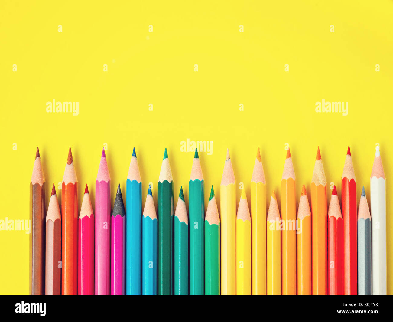 Colored Pencil On Yellow Paper Background For Drawing. Color Circle  Colored Writing Paper