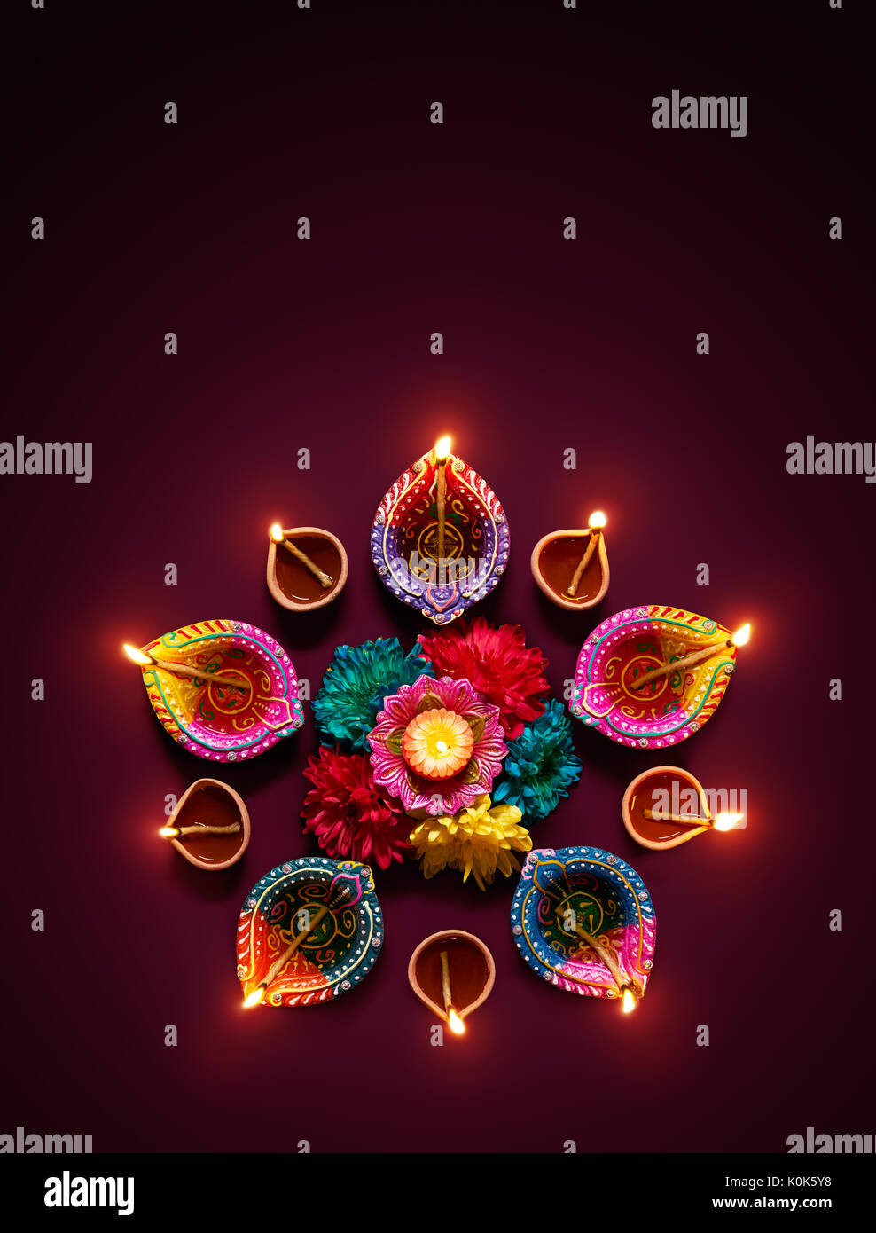 Diwali Oil Lamp - Colorful clay diya lamps with flowers Stock ... for Clay Lamp Design  131fsj