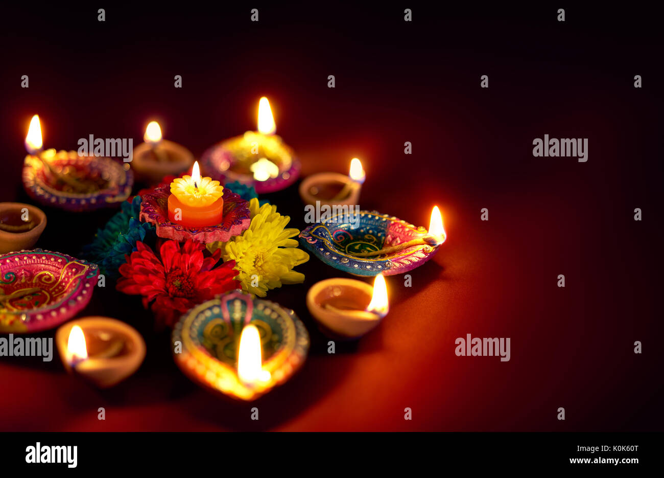 Diwali Oil Lamp - Colorful clay diya lamps with flowers Stock Photo on diwali clip art, diwali pooja, diwali in dipa, diwali lanterns, diwali diva, diwali graphics, diwali lakshmi, diwali gods, diwali goddess coloring page, diwali decoration ideas, diwali celebration india, diwali festival, diwali lights, diwali aarti thali decoration, diwali celebrations in trinidad and tobago, diwali to learn words, diwali rangoli, diwali animated, diwali fireworks, diwali greetings,
