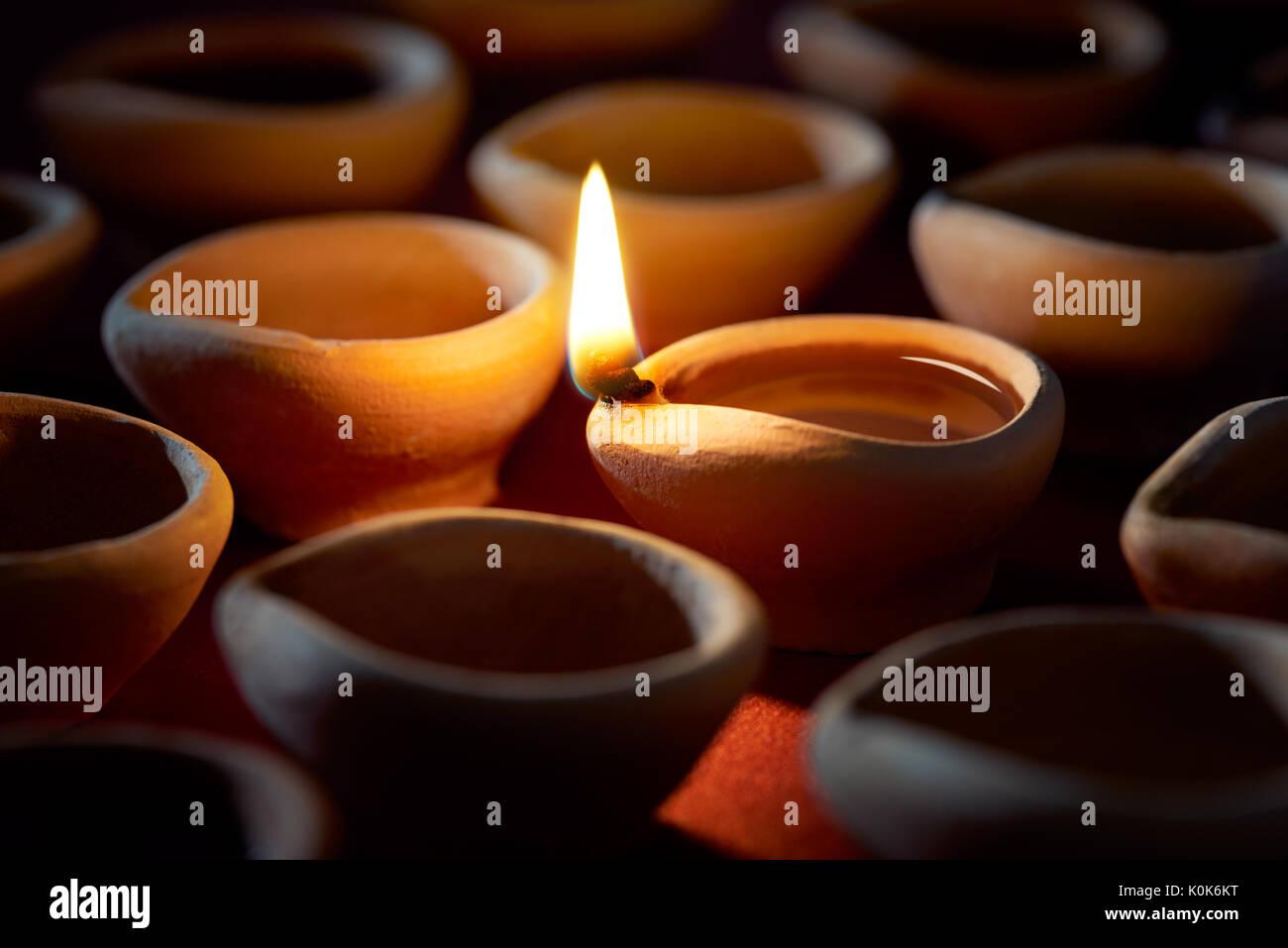 Traditional clay diya lamps lit during Diwali celetion Stock ... on diwali lanterns, diwali to learn words, diwali graphics, diwali festival, diwali greetings, diwali pooja, diwali decoration ideas, diwali clip art, diwali gods, diwali goddess coloring page, diwali rangoli, diwali animated, diwali celebrations in trinidad and tobago, diwali lakshmi, diwali fireworks, diwali diva, diwali in dipa, diwali celebration india, diwali lights, diwali aarti thali decoration,