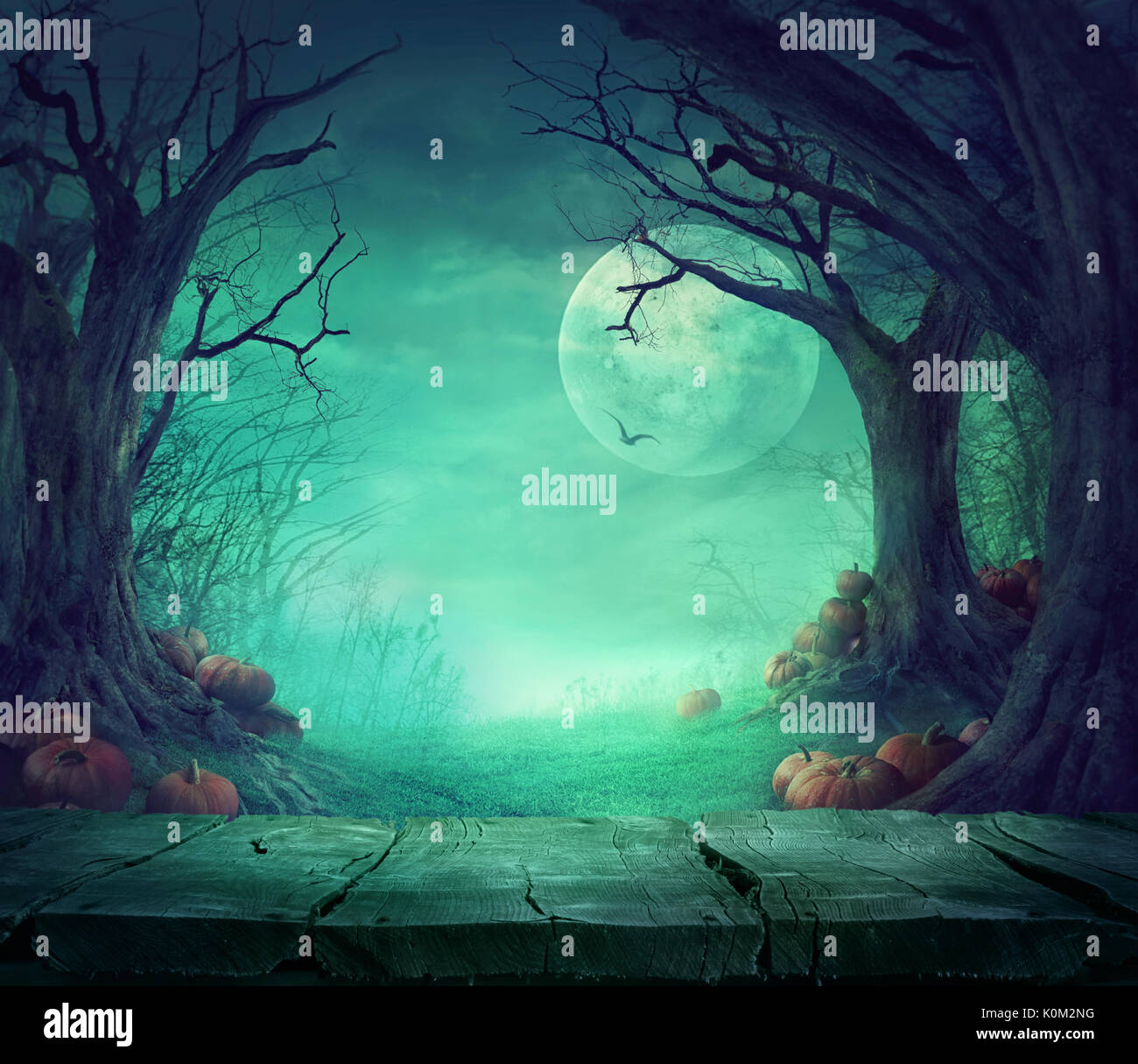 Halloween background. Spooky forest with dead trees and pumpkins ...