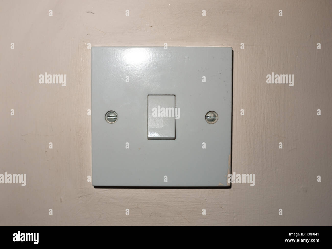 Close Up Isolated White Bedroom Light Switch Turned Off England
