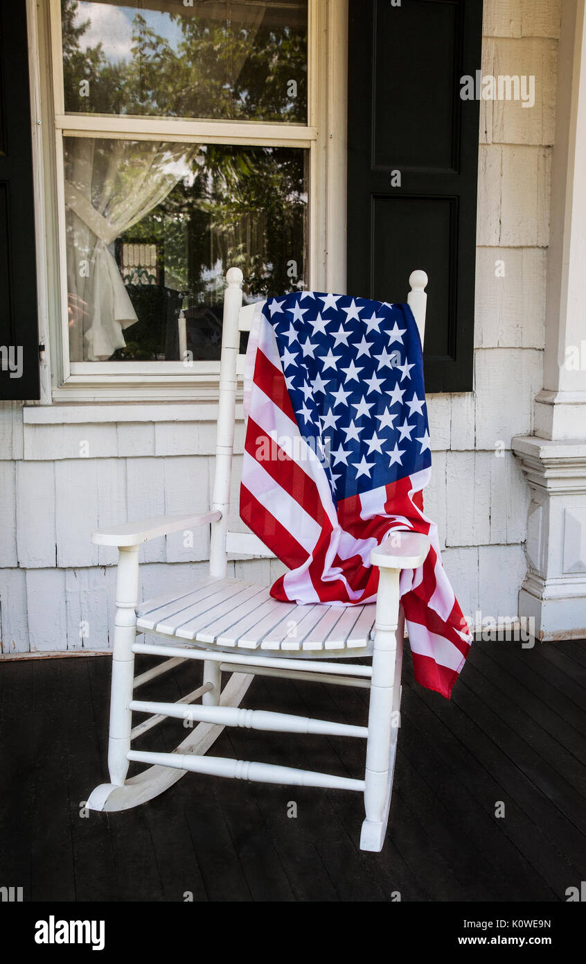American Flag On A Vintage Rocking Chair On A Historic House Porch,  Freehold Township, New Jersey, USA, Abstract