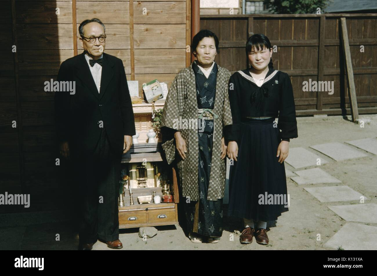 Japanese Family At Missionary Church Mature Man In Suit And Bow Tie Standing With His