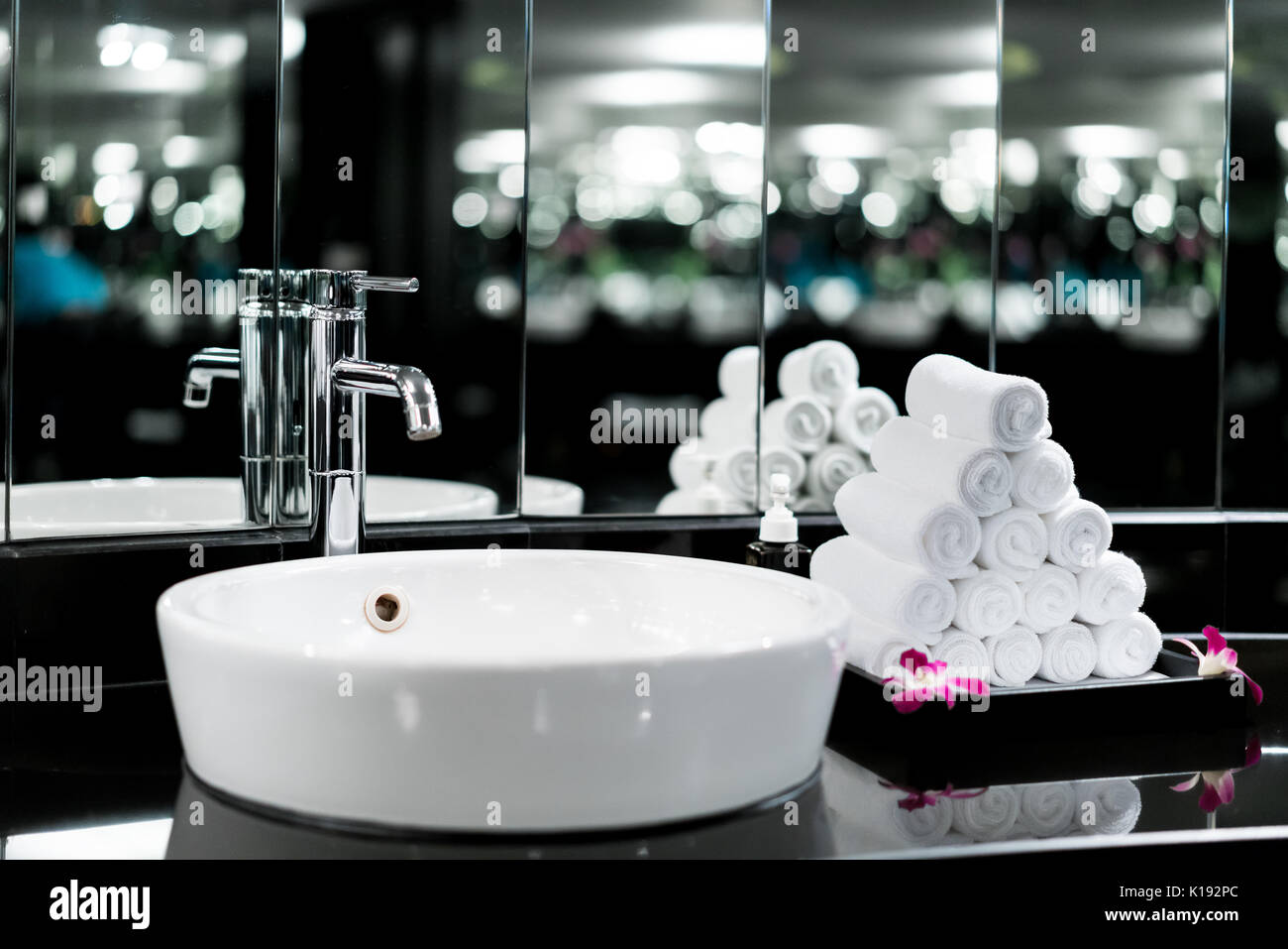 Interior of bathroom with washbasin faucet and white towel in hotel ...