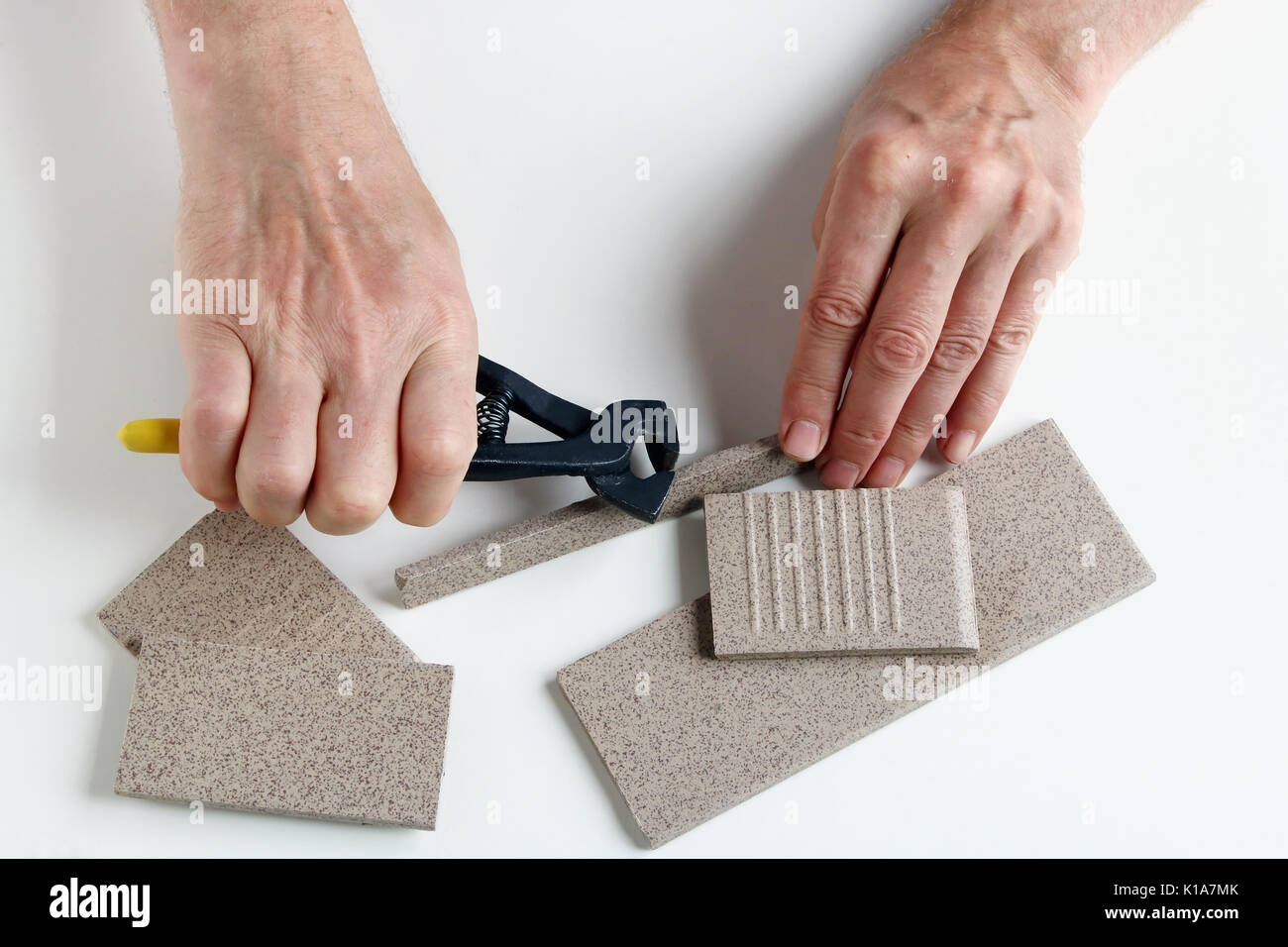 Cutting ceramic tile by hand