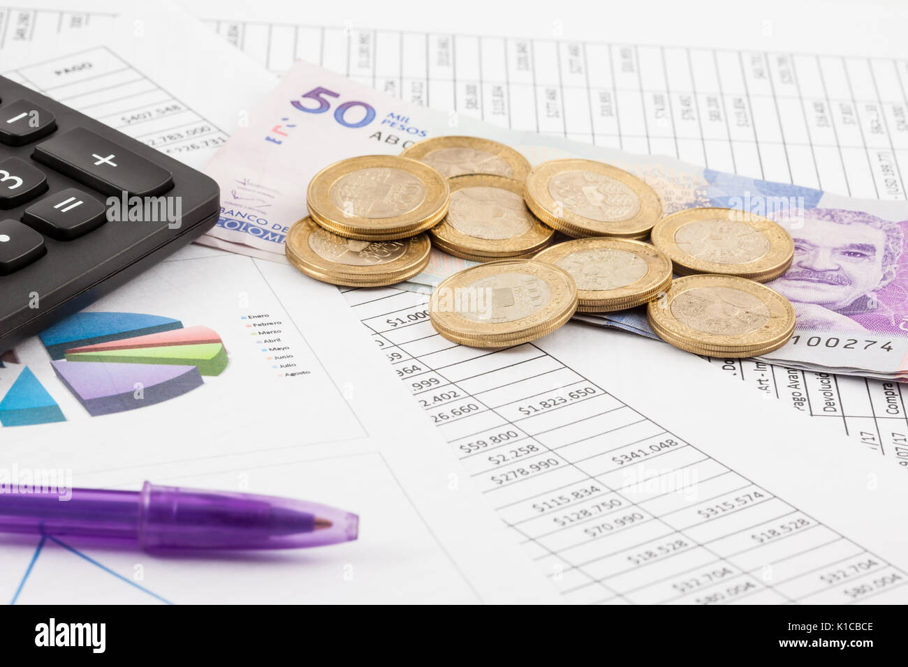 monthly budget spreadsheet money pen and calculator stock photo