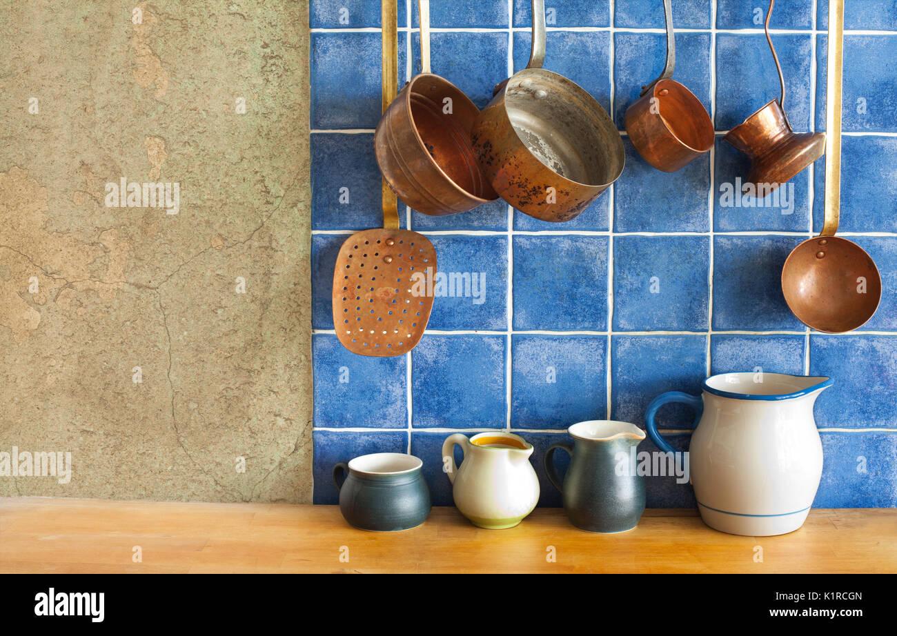 Kitchen interior. Hanging retro design copper kitchenware set. Pots ...