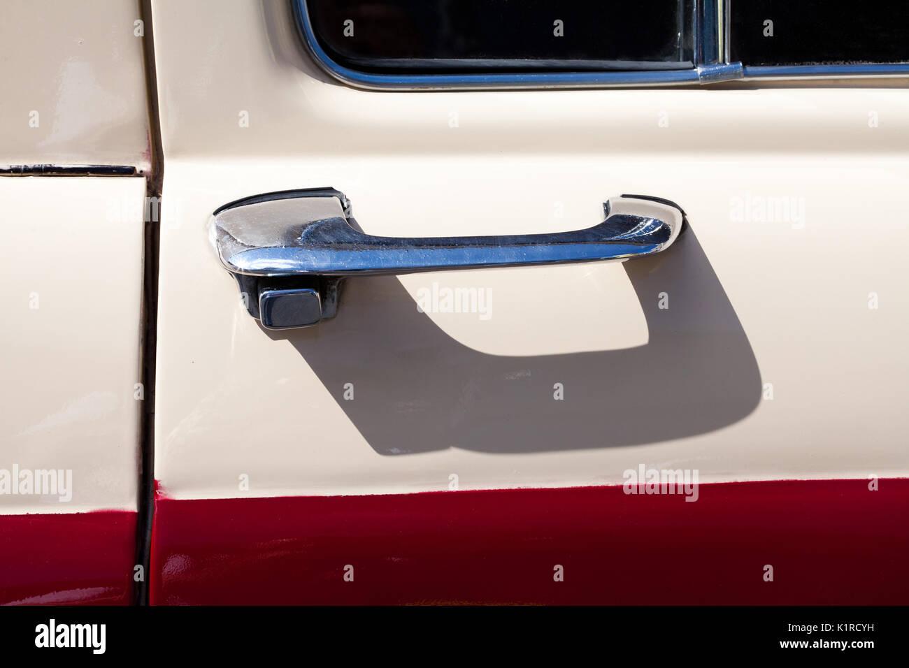 classic car door handle. Chromed Classic Car Door Handle - Stock Image
