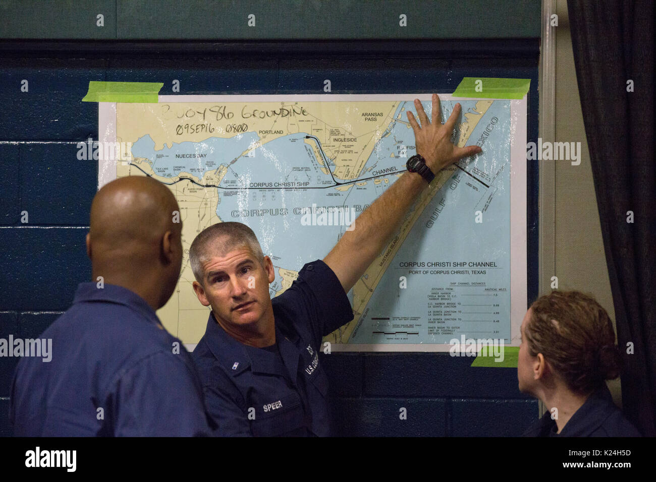 members of the u s coast guard reference a map of the corpus christi area during search and rescue planning august 27 2016 in robstown texas