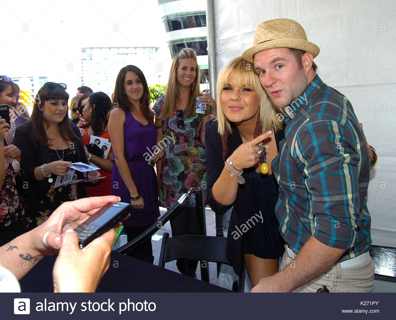 Kimberly caldwell and blake lewis former american idol performers former american idol performers meet and greet fans outside for autographs and photos at la live next to the staples center in los angeles california m4hsunfo