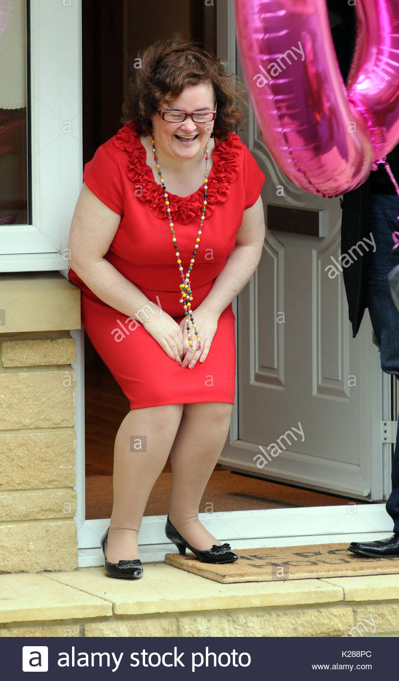 Susan boyle susan boyle glams up for her 50th birthday as she shows susan boyle glams up for her 50th birthday as she shows off her cards balloons and flowers on the steps of her new home in a shining red dress and izmirmasajfo