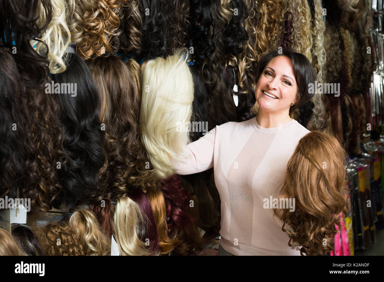Hair extensions stock photos hair extensions stock images alamy portrait of happy woman looking at different color hair extensions in shop stock image pmusecretfo Gallery
