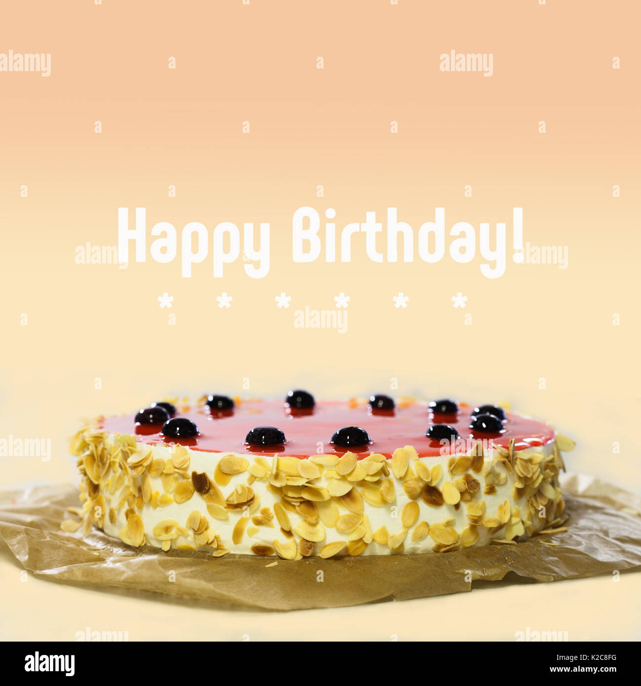 Happy birthday card cake with black cherry red jelly almond stock happy birthday card cake with black cherry red jelly almond flakes sweet dessert on peach color gradient background kristyandbryce Image collections